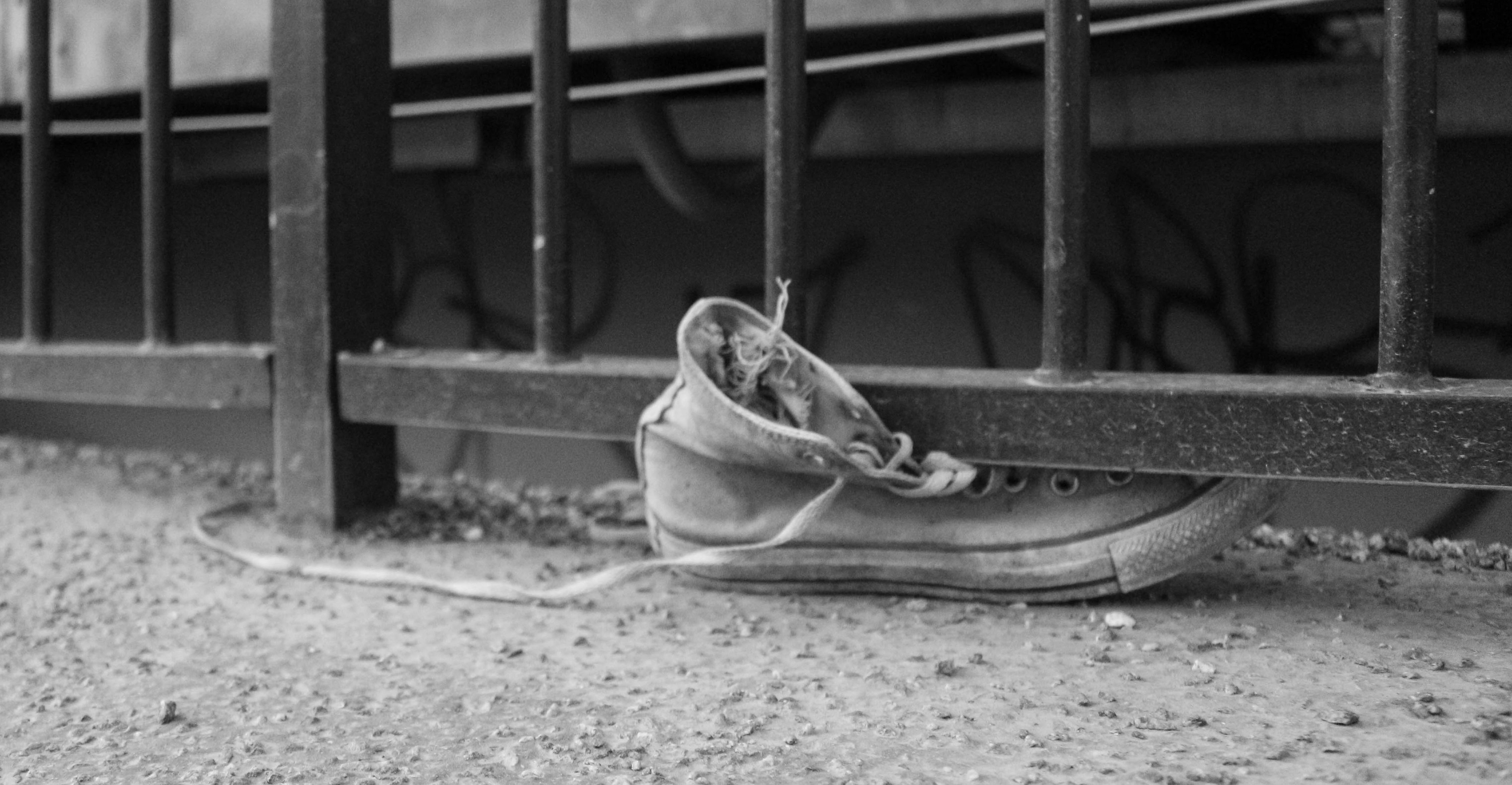 A shoe stuck in the railing of a bridge in Stockholm